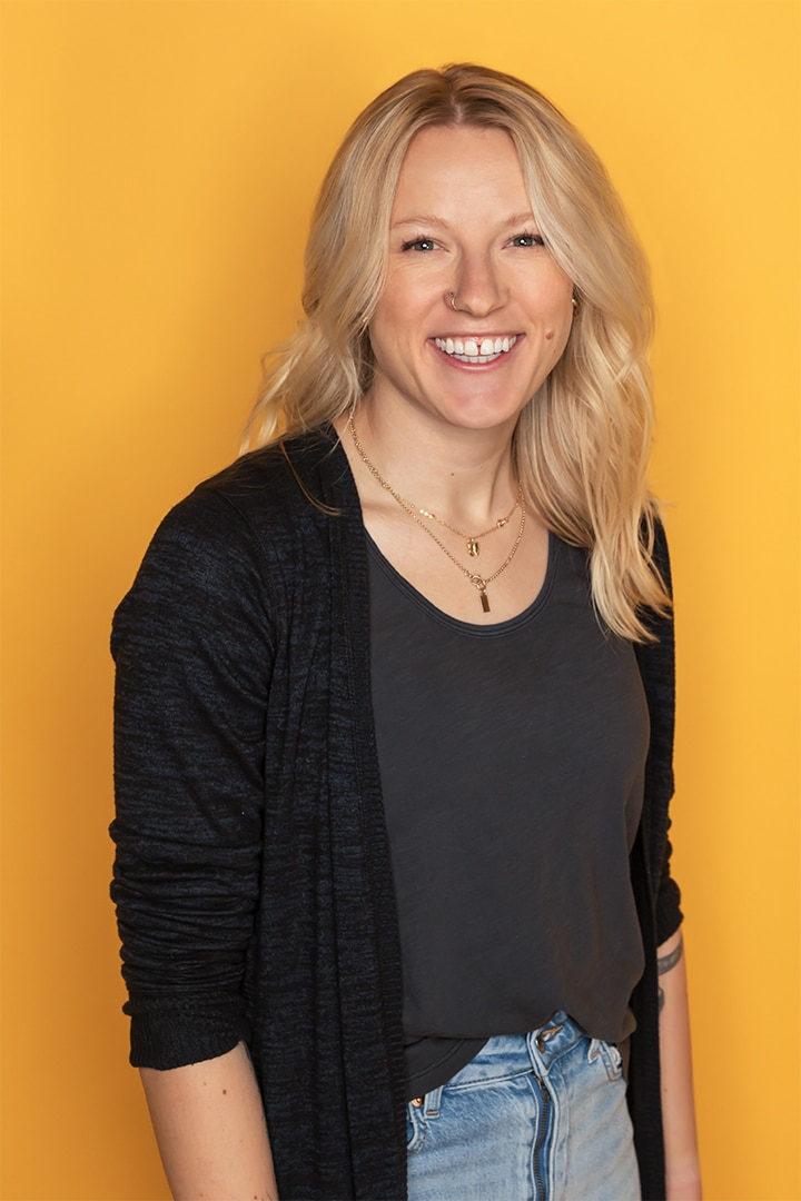 Woman with black shirt on yellow background